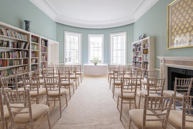 High ceilings, a marble fireplace and shelves stacked with beautiful books make the Library a wonderful backdrop for intimate wedding ceremonies.