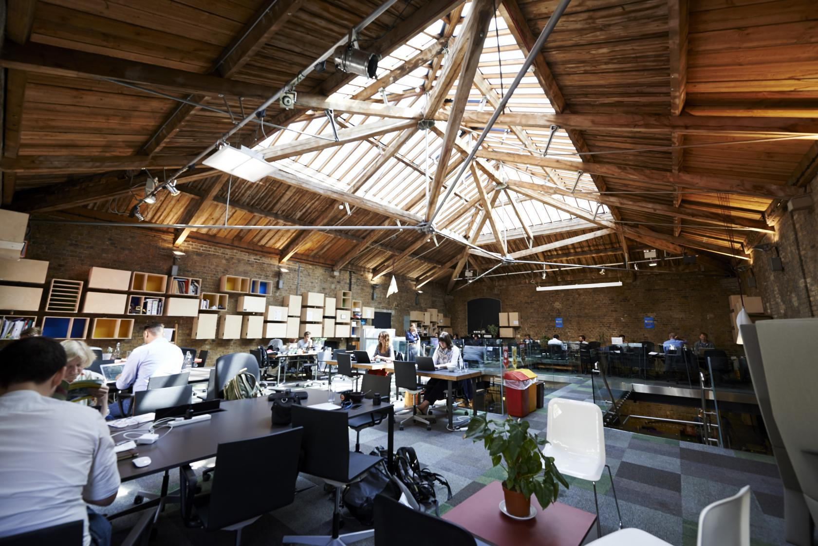 Refurbished in 2007 as a co-working hub, this grade II listed building still embodies the character of its warehouse heritage, with exposed bricks and steel beams on show under a modern skylight that floods the space with natural light.