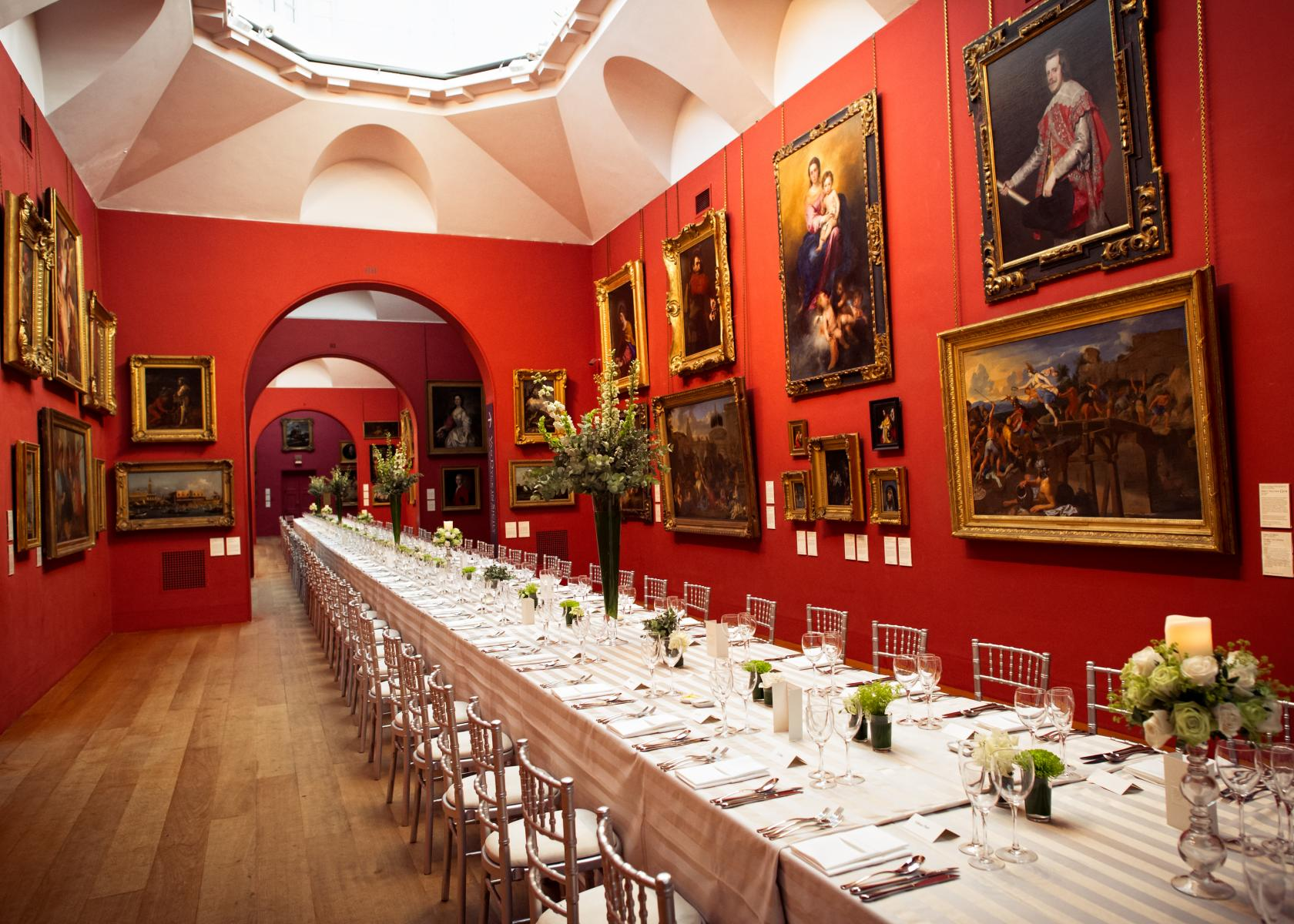 This magnificent Victorian events space boasts rich red walls and Old Master paintings.