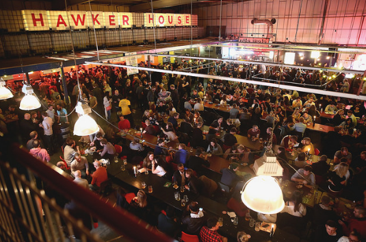 Dust off your dirndl and launder your lederhosen because this Oktoberfest, Hawker House will transform into a bustling indoor beer hall.