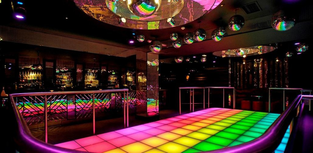 30th Birthday Party Venue Ideas London - 80s Amber Bar Groovy Wonderland