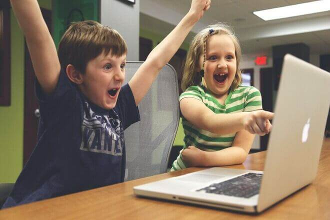 kids at computer laughing