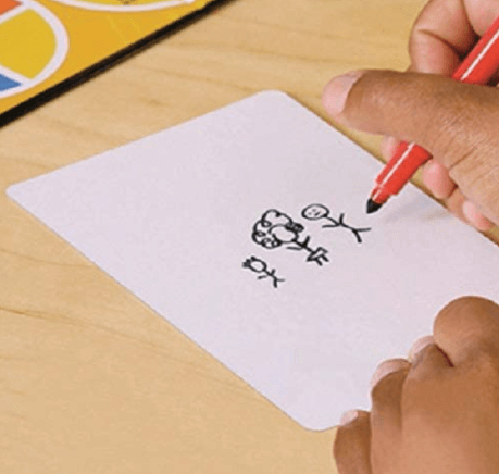 person drawing pictionary clue