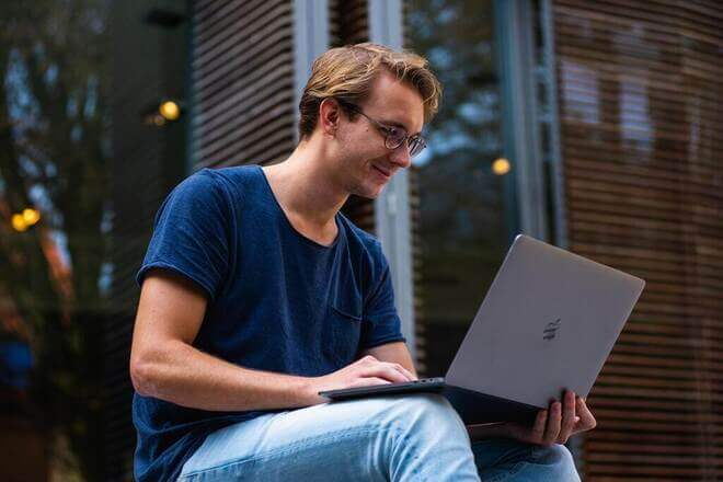 happy man on computer