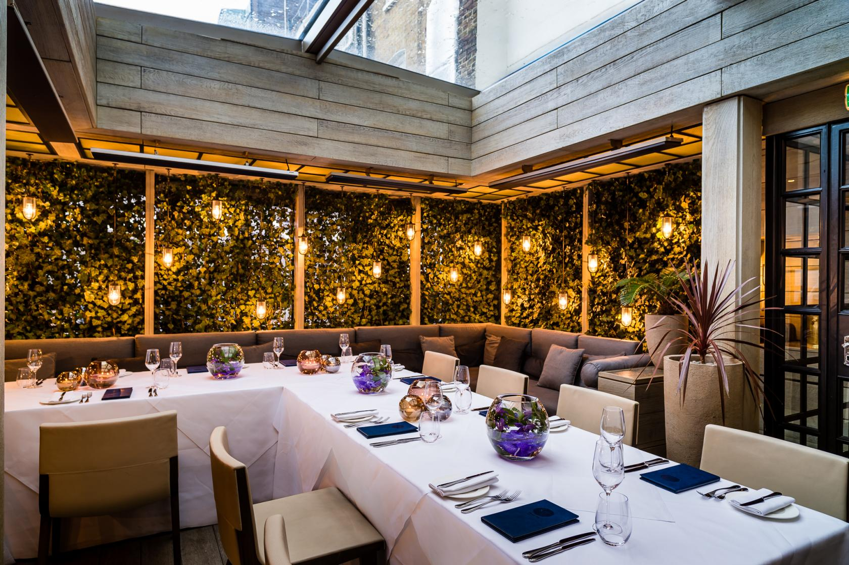 The garden terrace at the hari private hire for Garden pool hire london